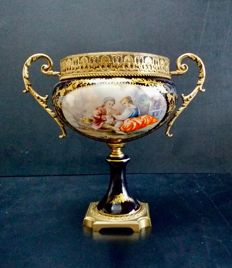 Porcelain dish on stand with hand-painted scene