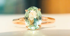 18kt gold ring with Light Green Tourmaline and diamonds.; No Reserve Price