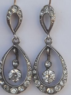 Vintage earrings in gold, silver and rock. 20th century.