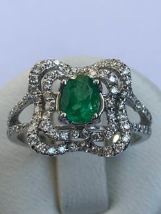 Very pretty gold ring with emerald and Top Wesselton diamonds.