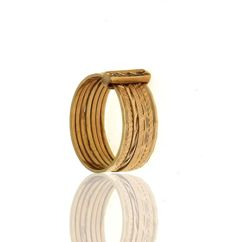 Ring with 7 loops, in 19.2 kt gold. Set with brilliant round-cut zirconia. . Size: 11