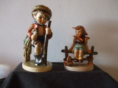 Two Hummel figurines: Just Restling and On Secret Path