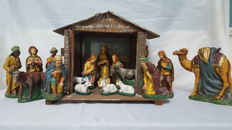 Detailed Christmas Group Consisting of 17 Items with a Wooden Stable - France - Circa 1900