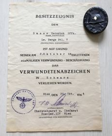 Wounded badge for the army in black and ownership certificate corresponding to the wounded badge in black, 1944