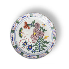 18th century polychrome Delft plate depicting flowers and a butterfly
