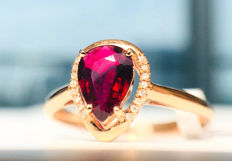 18kt gold ring with Red Tourmaline 0.6ct. and diamonds 0.08ct. Size 54