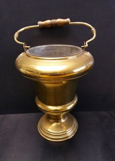 Very large holy water font made of brass