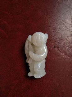 "A pendant figurine of child wearing  chinese ""Ruyi"", Jade – China – late 20th century."