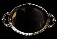 An elegant ,  silver plated  , vintage , large oval tray  , with two big handles  , 1980´s
