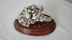 Cornucopia in rolled silver on wooden base