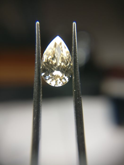 0.61 ct Pear cut diamond Fancy Light Yellowish Brown  -No Reserve