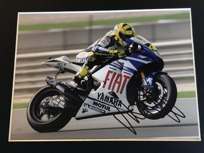 Nice framed image, personally signed by Valentino Rossi