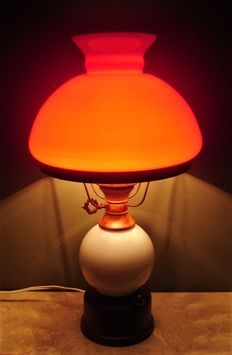 Petroleum table lamp with a red opaline shade