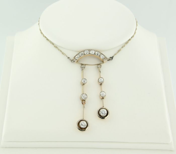 18 kt bi-colour gold / 835 silver with silver necklace, set with 12 Bolshevik cut diamonds, 1.40 ct in total.