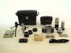 Leica M3 with Summicron F 2-50 mm, Summaron F 2.8-35 mm, Elmar F 4-90 mm, Elmar F 4-135 mm, light meter, table tripod, ball head, camera case, camera bag, flash, filters, lens hoods