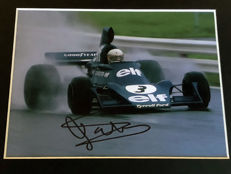 Nice framed image, personally signed by Jody Scheckter