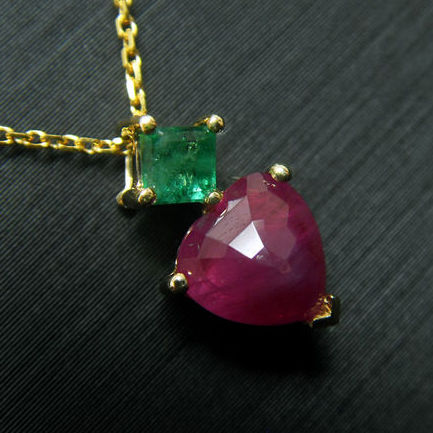 14 kt yellow gold necklace with 1.02ct of  ruby and 0.16ct of emerald