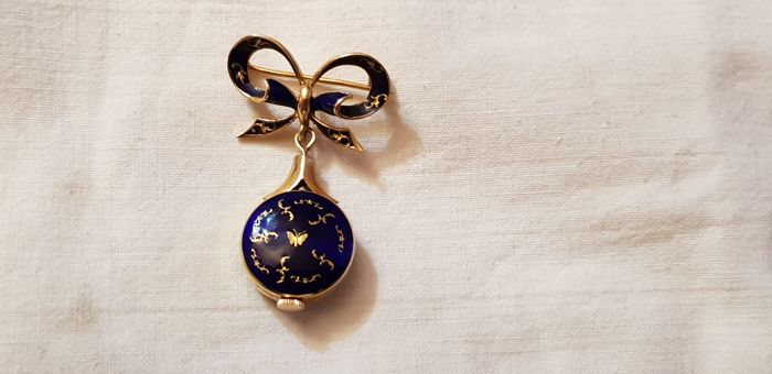 Brooch-timepiece in 18 kt gold and enamels