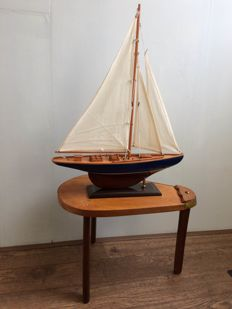 Unusual side table in the shape of a sword and a sailing yacht