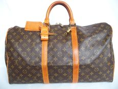 Louis Vuitton  Keepall 50 + LV accessories + LV padlock (312) with 2 keys - **No reserve price**