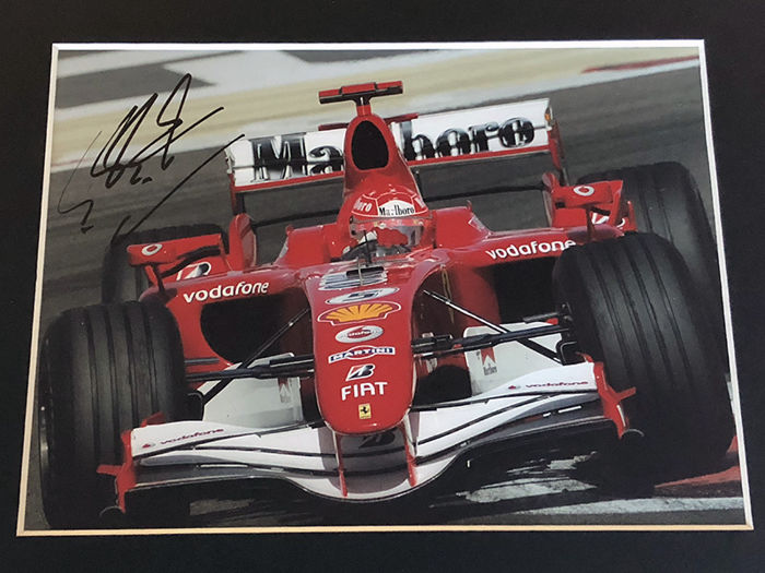 Nice framed image, personally signed by Michael Schumacher