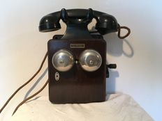 Wooden wall telephone with bakelite receiver from 1910.