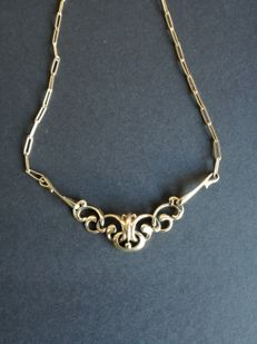Fons Reggers: 14 kt yellow gold necklace, with small links.