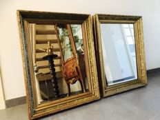 Rare pair of rectangular wall mirrors - each in Renaissance-style list of gilded paste on wood - 19th century