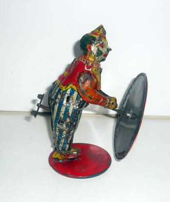 Günthermann, Germany - height 12 cm - clockwork tin clown with bike, early 20th century. ""