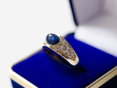 Gold ring with large sapphire and diamonds
