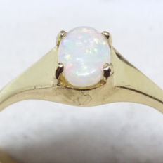 0.27 cts Opal Ring of 14KYellow Gold.  Ring size M to N.