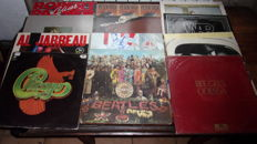 lot of 12 LP of various artists including The Beatles , Procol Harum , Steve Winwood and Many more