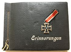 The Iron Cross 1939 2nd class and a vintage photo album with memories