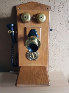 Old wooden wall telephone with dial and separate mouthpiece