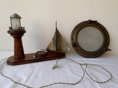 Antique Copper Porthole with matte glass, Schiedam, Holland. Brand Vetus. Antique ship with lit lighthouse made in Egypt