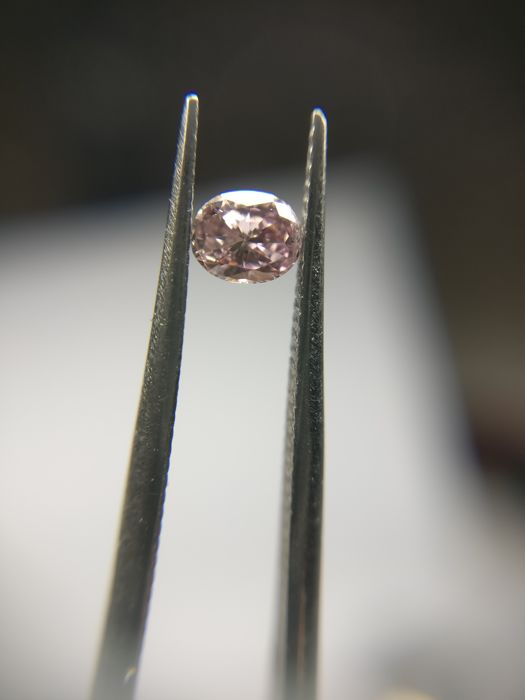 0.11 ct Oval cut diamond Fancy Brown Pink