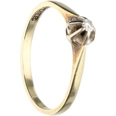 14 kt - yellow gold ring set with 1 brilliant cut diamond of 0.04 ct in total in a white gold setting - ring size: 17 mm.