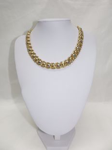 Articulated and reversible choker in 18 kt bicolour gold