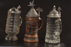 Three (3x) antique German beer jugs, 2x with crystal and 1x earthenware, ca. 1900