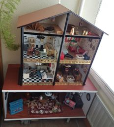 Doll's house in two parts filled with interior furniture, nice items