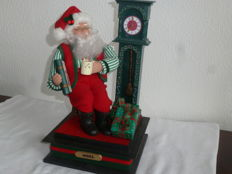 Beautiful music box featuring Santa Claus with a mug