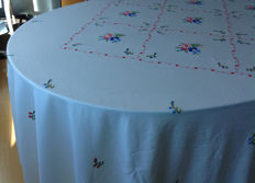 Round hand-embroidered table linen