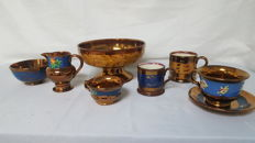 Collection of English gold stone dinnerware pieces