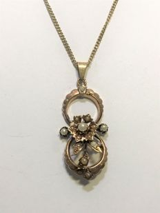 14 kt yellow gold pendant with curb link necklace, 44 cm long