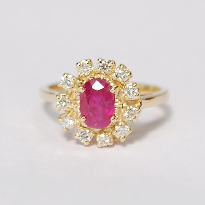 18ct gold ladies ring, Yellow 18 ct. gold and 0.92 ct Rich Pinkish Red Burma Ruby and 11 diamonds: 0.33 ct Total Weight