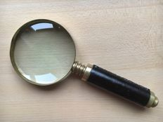 Bronze magnifying glass with leather handle, first half of the 20th century, London