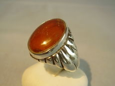 Solid men's ring with natural,  opaque amber weighing 7 ct, made circa 1935/40