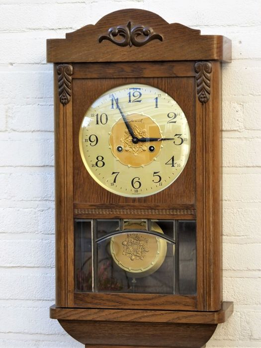 Beautiful oak wall clock - almost in mint condition - circa 1970