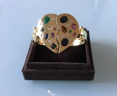 Heart-shaped bracelet in 18 kt yellow gold with brilliant cut diamonds totalling approx. 1 ct and gemstones