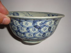 A Chinese blue and white porcelain bowl with rich flower decoration - 150 X 72 mm
